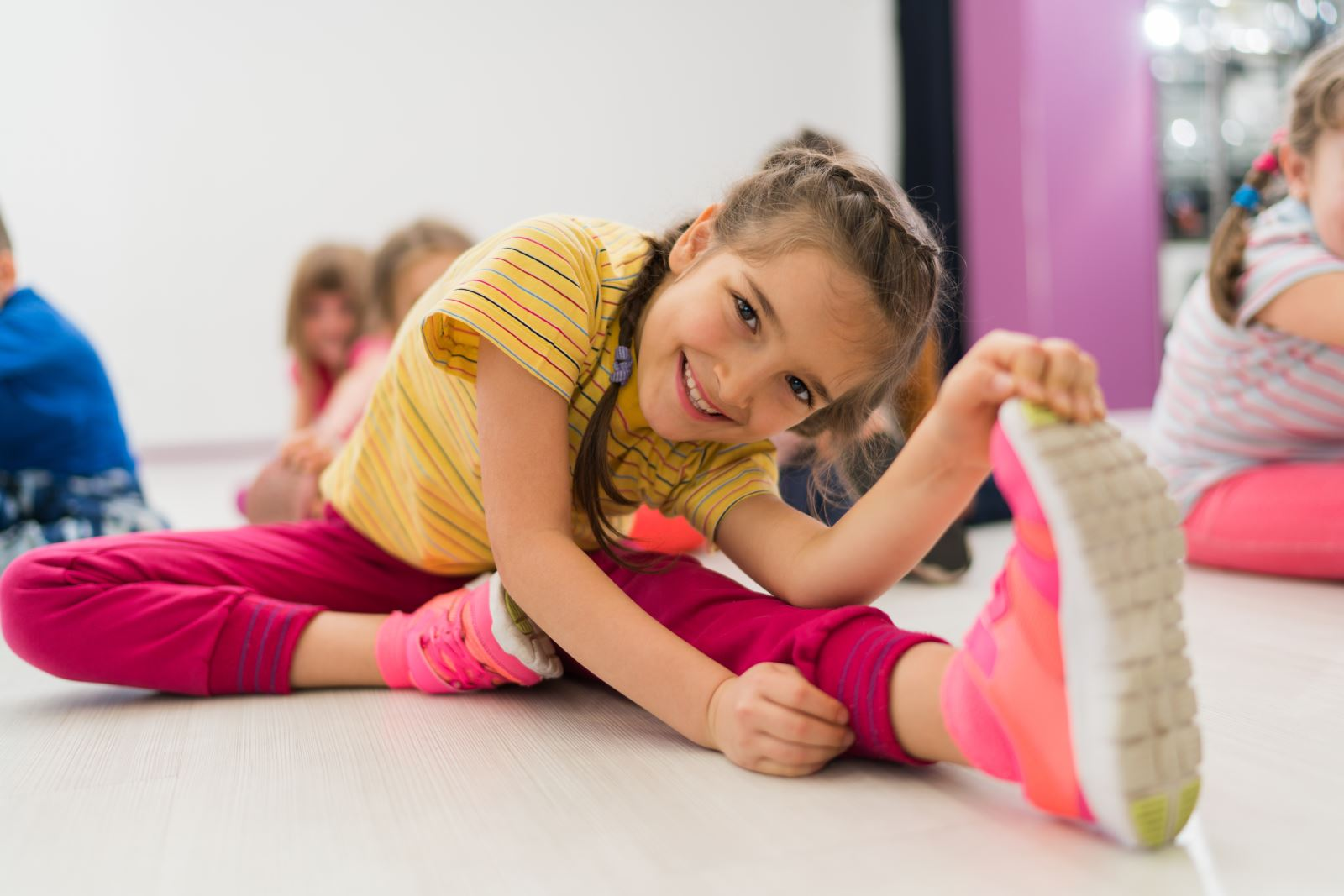 young girl stretching